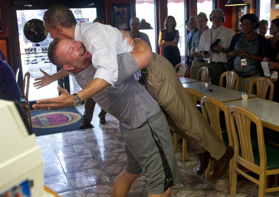Obama raised in hug by restaurant owner